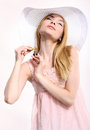 Romantic scent happy blonde in a hat perfume body Royalty Free Stock Photography