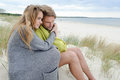 Romantic seaside lovely couple in sand dune - autumn, beach Royalty Free Stock Photo
