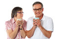 Romantic senior couple holding coffee mugs Stock Photography