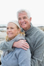 Romantic senior couple on rocky beach closeup of a together a Stock Photography