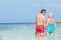 Romantic senior couple standing in beautiful tropical sea holding hands Royalty Free Stock Photos