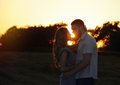 Romantic sensual young couple in love posing in summer field at Royalty Free Stock Photo