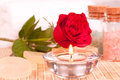 Romantic spa concept with candlelight and rose close up Royalty Free Stock Photography