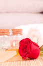 Romantic spa getaway with red rose close up Royalty Free Stock Photo