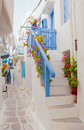 Romantic street of greek island with flowers and white buildings mykonos Stock Images