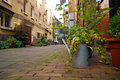 Romantic street view, full of flowers and greenery Stock Photo