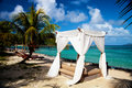 Romantic sunlounger for honeymooners Royalty Free Stock Photo