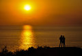 Romantic sunset scene with couple silhoutte Royalty Free Stock Photo