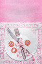 Romantic table place setting with sign decoration and message with love and for you on pink background, top view