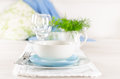 Romantic table set up for two white and blue serving Royalty Free Stock Image