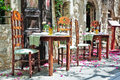 Romantic tables image of a outdoor greek restaurant Royalty Free Stock Photo
