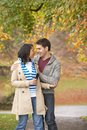 Romantic Teenage Couple In Autumn Park Stock Images