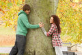 Romantic Teenage Couple By Tree In Autumn Park Stock Photography
