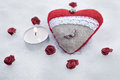 Romantic Valentine Plush Heart With A Winged Metal Heart On Ice Besides A Peaceful Tea Light Surrounded By Rose Bloom Royalty Free Stock Photo