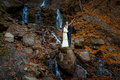 Romantic wedding couple. Waterfall on background. Honeymoon in the mountains Royalty Free Stock Photo
