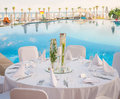 Romantic wedding setting decorated table for a reception at beach resort Stock Photo