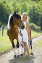 Romantic woman with horse a beautiful walking her barefoot wearing a white dress Stock Photo