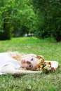 Romantic woman lying down on grass Stock Photos