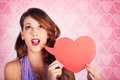 Romantic woman shouting out message of love through blank heart shaped speech bubble Stock Images