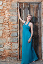 Romantic young blond woman on stone wall back Stock Image