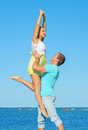 Romantic young couple dancing by the sea Stock Photography