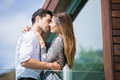 Romantic young couple kissing in balcony low angle view of at resort Stock Photography
