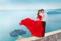 Romantic young couple in love over blue sea shore background. Fa