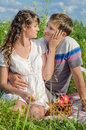 Romantic young couple resting outdoors and tenderlt touching eac each other Royalty Free Stock Photography