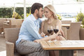 Romantic young couple spending quality time at outdoor restaurant Royalty Free Stock Images