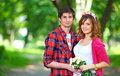 Romantic young couple in spring park colorful Royalty Free Stock Photos