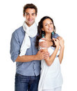Romantic young couple standing together on white Stock Photos