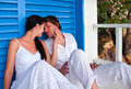 Romantic young couple in tropical beach house Royalty Free Stock Photo