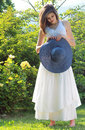 Romantic young girl with blue hay hat and daisy Royalty Free Stock Image