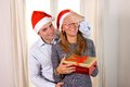 Romantic young man giving christmas present men surprise to happy woman Royalty Free Stock Image