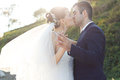Romantic young newlywed kissing at garden couple park or Stock Photos