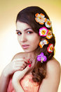 Romantic young woman with flowers beautiful girl in hair holding hands Stock Images