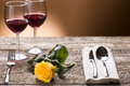 Romantically laid table with yellow roses and wine romantic atmosphere two glass for Stock Photos
