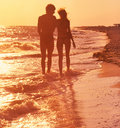 Romanticism couple in love young people strolling along the seashore Stock Photo