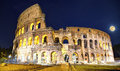 Rome colosseum by night picture of the in italy in the evening with full moon Royalty Free Stock Photo