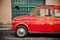 ROME, ITALY - APRIL, 25: Retro small red Italian car Fiat 500 at the street of Rome, April 25, 2013 Royalty Free Stock Photo