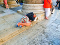 Rome, Italy - September 10, 2015: A homeless woman sleeping lying at Panteon in the center of Rome, Italy Royalty Free Stock Photo