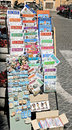 Rome italy tourist magazine stand on sidewalk in Stock Photo