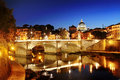 Rome, Italy - view of a bridge over Tiber river and St. Peter& x27;s Basilica dome in Vatican at night Royalty Free Stock Photo