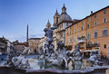 Rome navona perspect italy piazza square at sunrise landmark fountains and chatolic church baroque art monuments blurred water Royalty Free Stock Photo