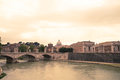 Rome panorama architectural of with tiber river and saint peter s basilica in the background at sunset Royalty Free Stock Image