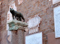 Rome symbol with a she wolf and romolo and remo bronze statue on a granite column in italy Royalty Free Stock Photo