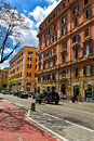 Rome urban scene old buildings in italy and daylight city traffic Stock Photography