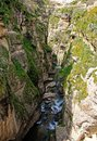Ronda spain gorge deep el tajo in with stream Stock Photo