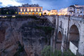 Ronda spanish town of at twilight famous old bridge at right side Stock Image