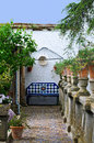 Ronda stone bench in a wonderful garden in andalusia spain Stock Photos
